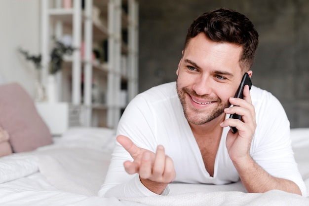 Smiley man talking over the phone