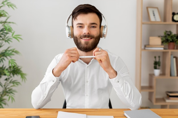 Smiley man wearing headphones