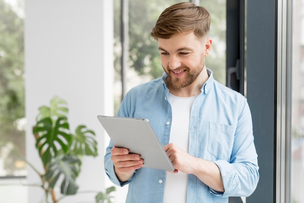 Smiley man with tablet