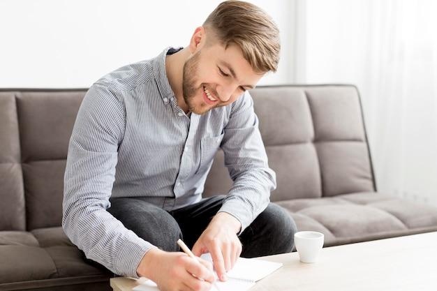 Smiley man writing
