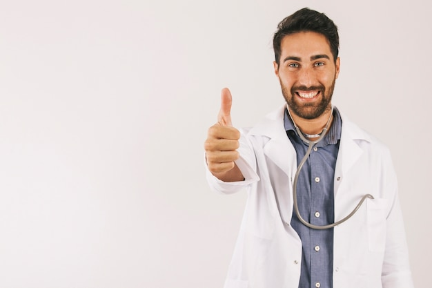 Smiley medical doctor posing with thumb up