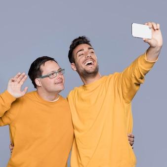 Smiley men taking a selfie together