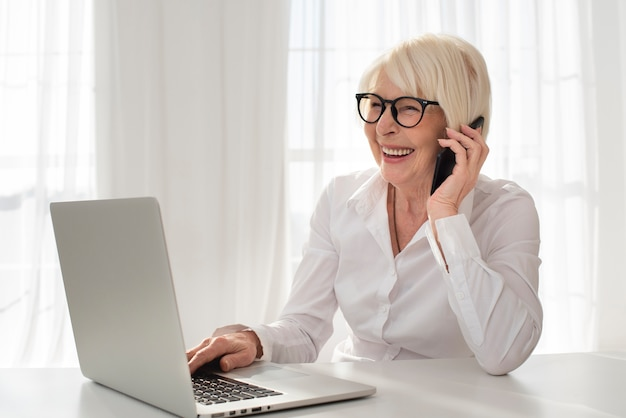 Smiley old woman talking on the phone