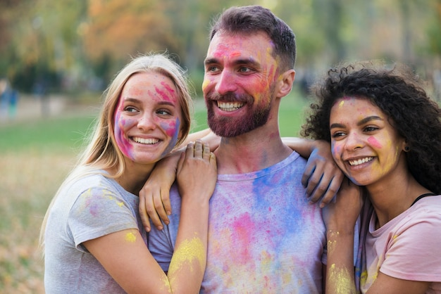Smiley people posing at holi