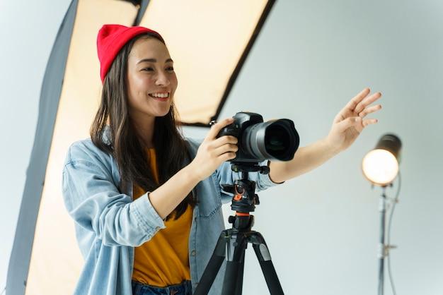 Smiley photographer taking shots
