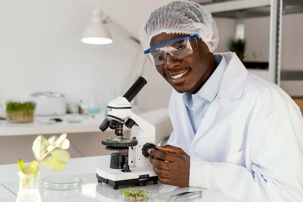 Smiley researcher using microscope