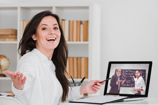 Smiley student showing her online courses