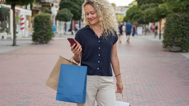 Smiley woman carrying shopping bags