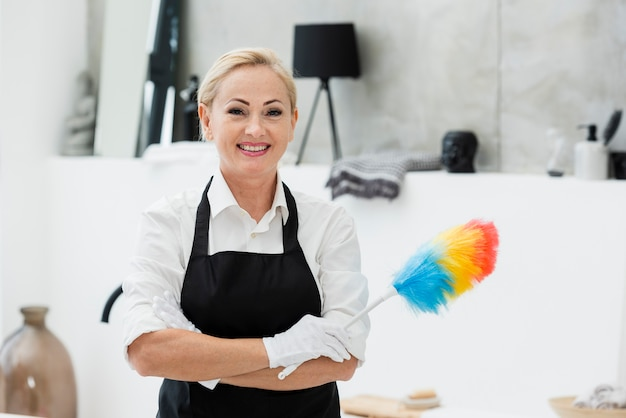 Smiley woman cleaning