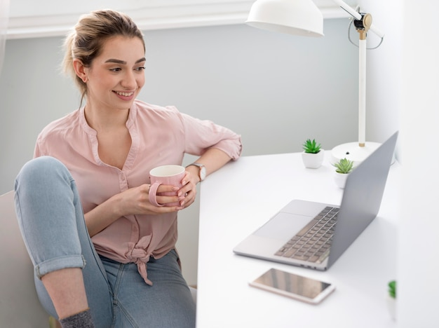 Smiley woman at desk working