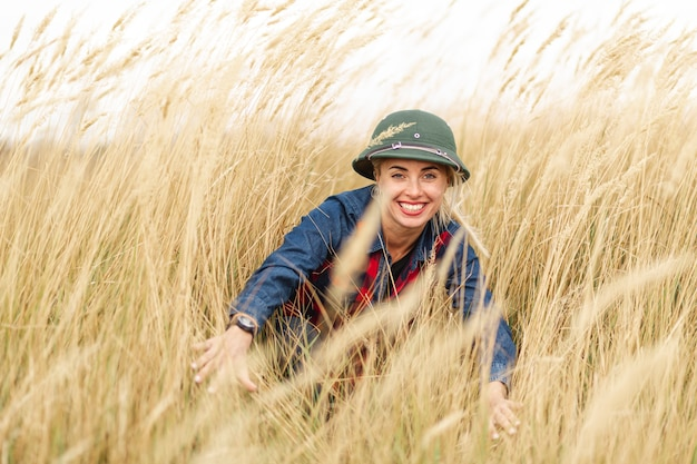 Smiley woman enjoying wheat