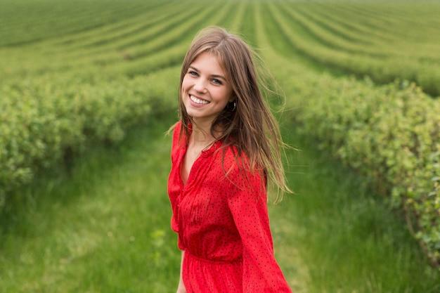Smiley woman in field
