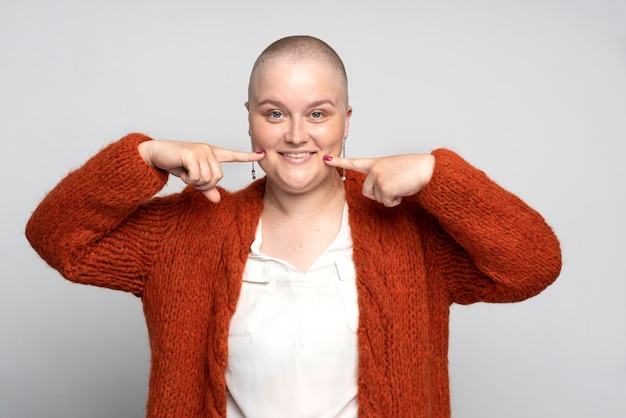 Smiley woman fighting breast cancer