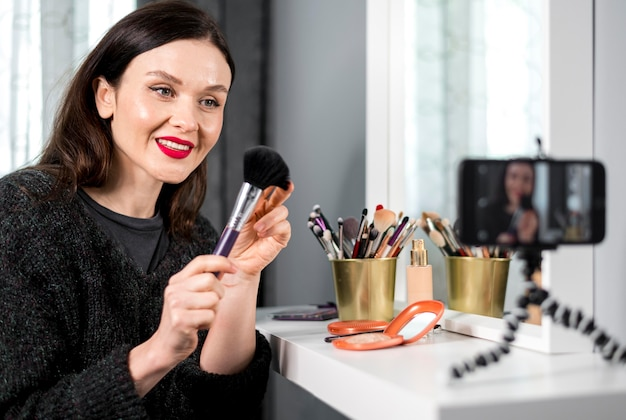 Smiley woman holding brush