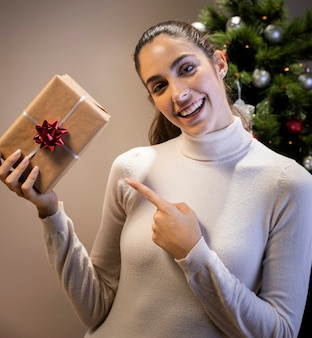 Smiley woman holding a gift