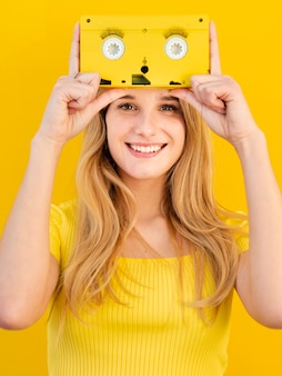 Smiley woman holding old tape