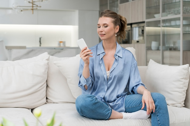 Smiley woman holding smartphone