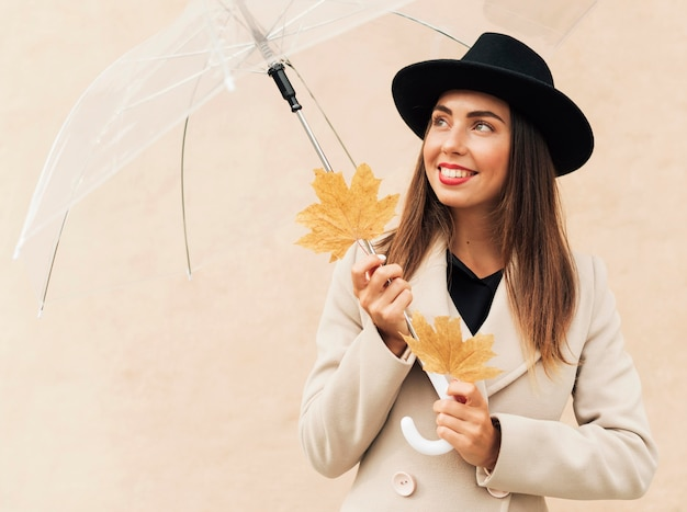 Smiley woman holding a transparent umbrella