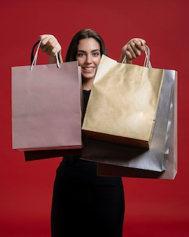 Smiley woman holding up her shopping bags