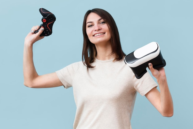 Smiley woman holding virtual reality headset