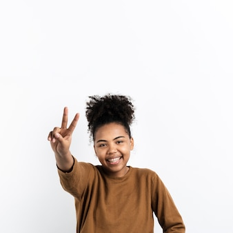 Smiley woman making peace sign