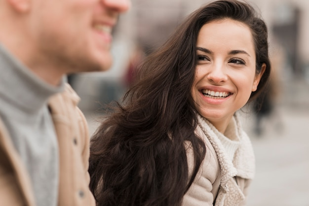 Smiley woman outdoors with man