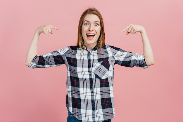 Smiley woman pointing to herself
