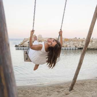 Smiley woman posing in swing