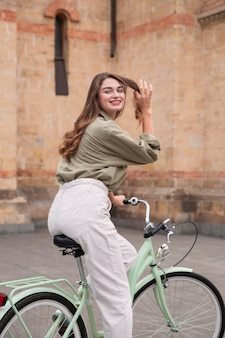 Smiley woman riding her bicycle in the city