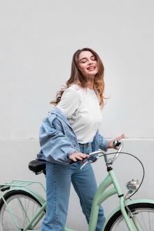 Smiley woman sitting on her bike