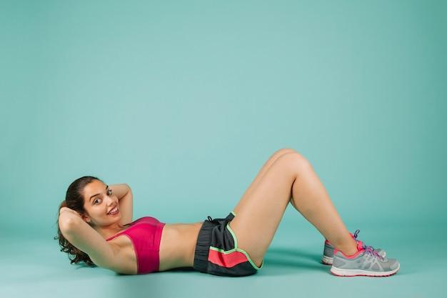 Smiley woman training abdominals