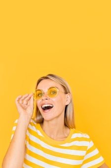 Smiley woman wearing yellow glasses