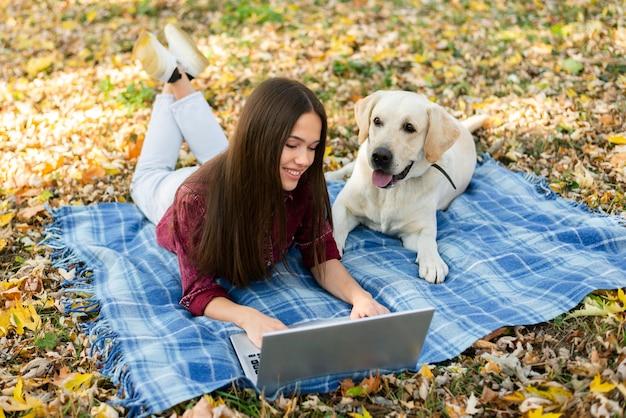 Smiley woman with a cute labrador