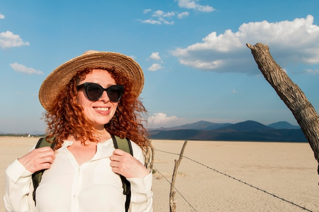 Smiley woman with hat traveling