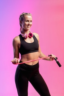 Smiley woman with jumping rope