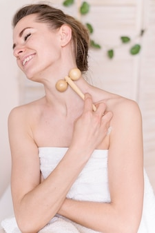 Smiley woman with massage tool