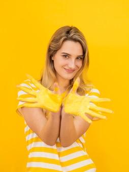 Smiley woman with painted hands