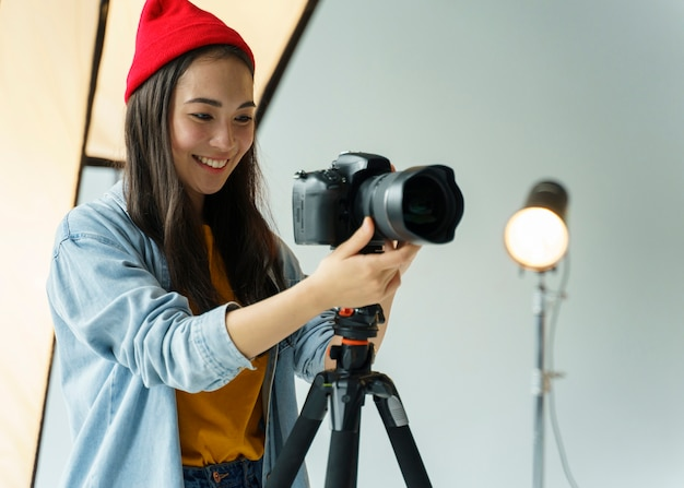 Smiley woman with photo camera