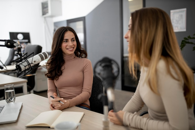 Smiley women broadcasting on radio together