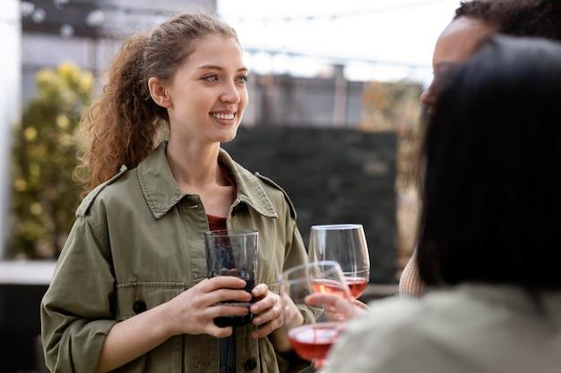 Smiley women holding wine glasses