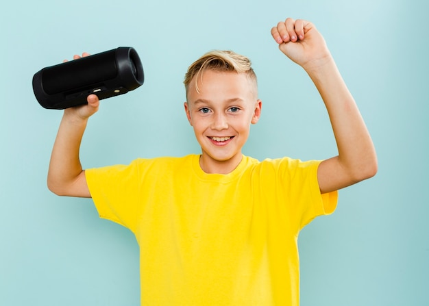 Smiley young boy holding cassette