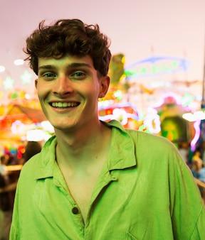 Smiley young man looking at camera