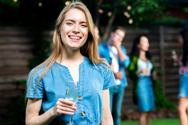 Smiley young woman with champagne glass