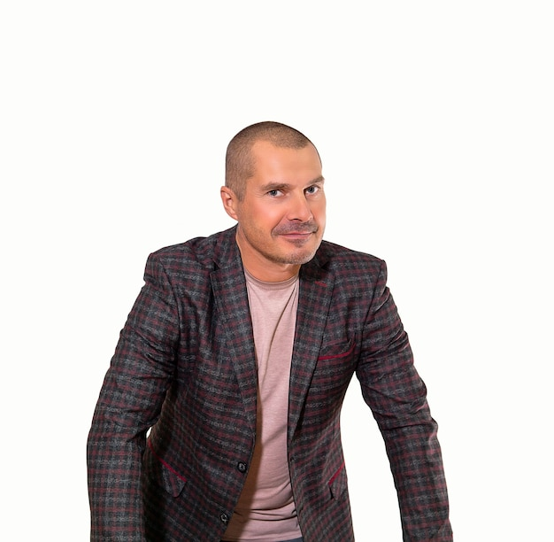 Smiling adult man dressed in free style leaned forward listening carefully, isolated on white background