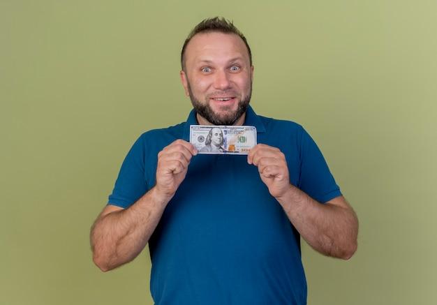 Smiling adult slavic man holding money looking