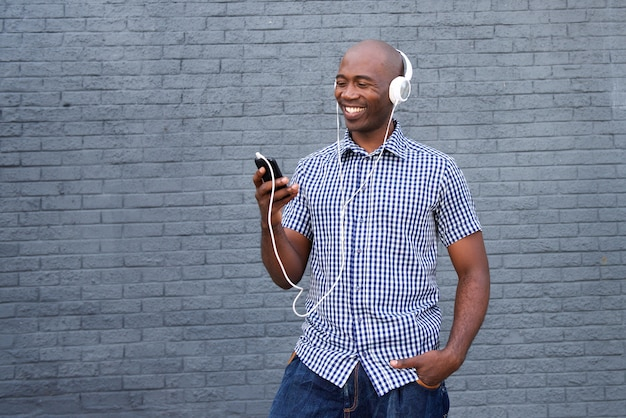 Smiling african american with headphones and smart phone
