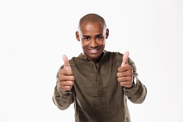 Smiling african man showing thumbs up and looking