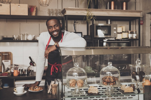 Smiling afro american barista male at work