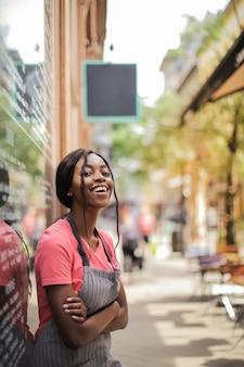 Smiling afro waitress