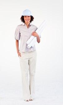 Smiling architect woman holding blueprints